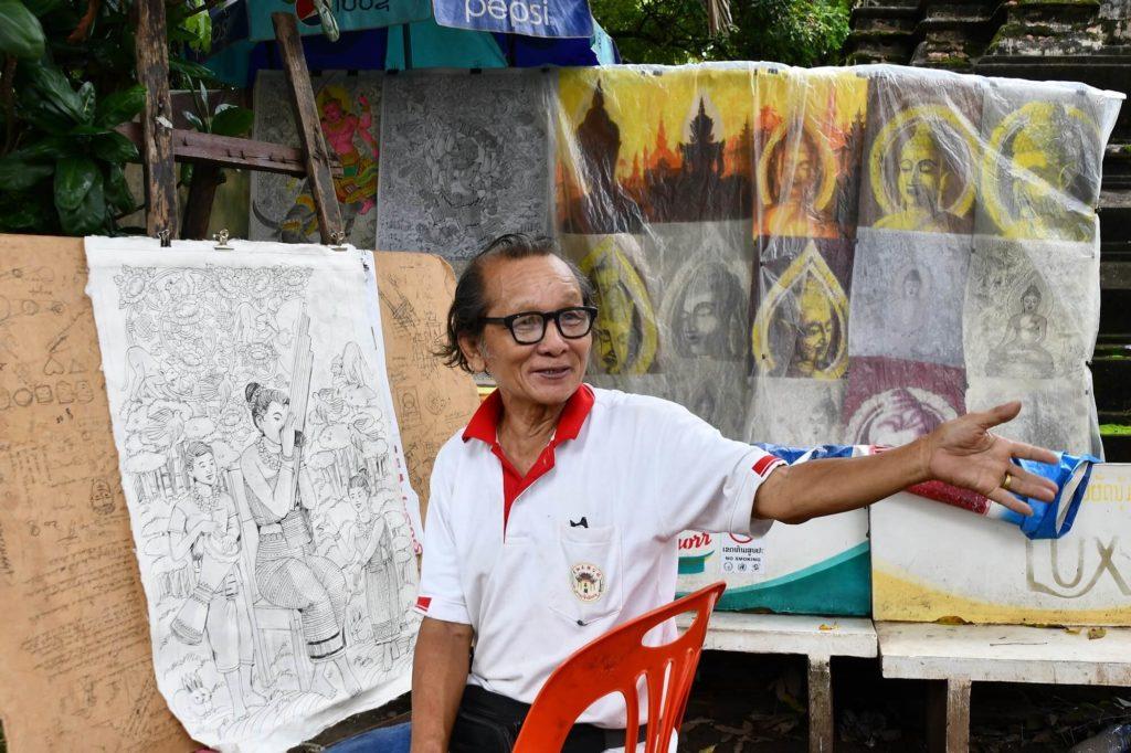 ラオスの象徴で、三年間絵を描き続ける男性